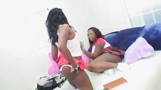 Hot bootylicious ebony lesbians fuck each other with strapon