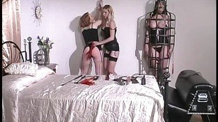 Hottie into BDSM playing around with 2 of her well?stacked slaves