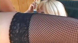 Lusty brunette gets her strap on deep throated by sexy blond