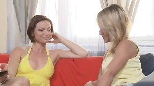 Two handsome lesbians having girl on girl action in bedroom