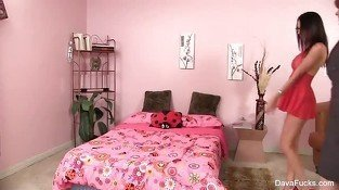 Dava and Lily Cade have fun on a pink bed